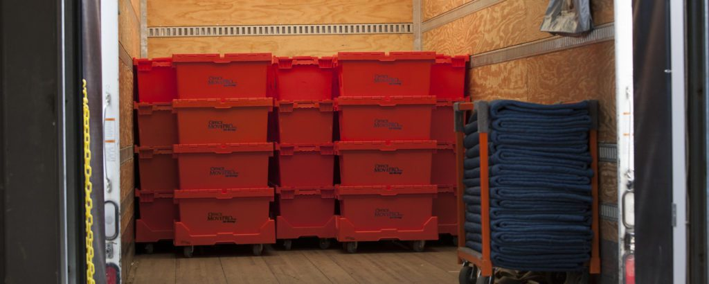 Stacks of Office Move Pro E-Crate Moving Box Rental