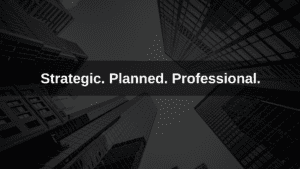 The words strategic, planned and professional superimposed on a cityscape